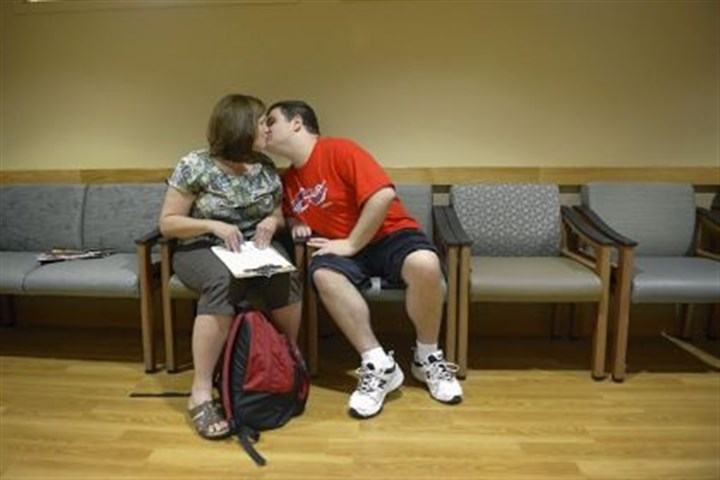 autism maloneys kiss Jeffrey Maloney gives his mother a kiss as they wait to see Jeffrey's neurologist at the Kaufmann Medical Building in Oakland. As part of his autism, he has many quick seizures that need to be monitored.
