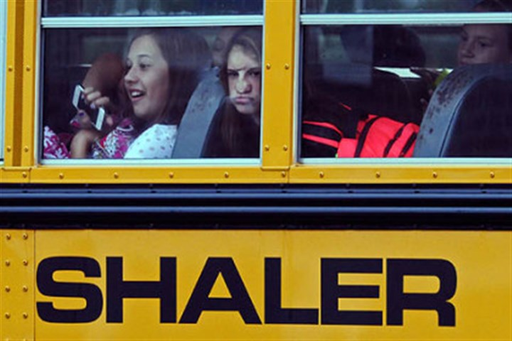 Back to class Students arrive this morning on a school bus round at the entrance of Shaler Area Middle School along Mount Royal Boulevard.
