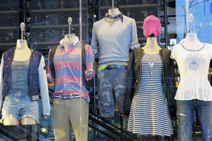 Back-to school fashions Back-to school fashions are displayed at American Eagle Outfitters. Shoppers, worried about their finances, showed they were more interested in buying discounted summer merchandise in July than in picking up new fall clothing for their children, according to figures released Thursday.