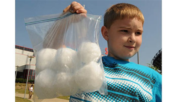 bag of snowballs Cory Thurston, 8, carries the six snowballs he saved in the freezer from last winter.
