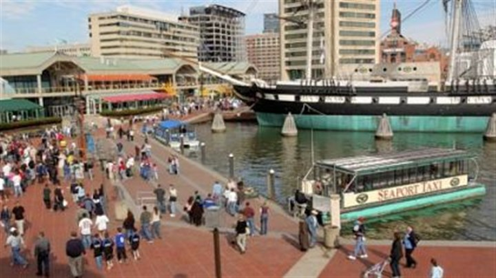 Baltimore's Inner Harbor A water taxi docks at Baltimore's Inner Harbor, a popular tourist destination in the city.