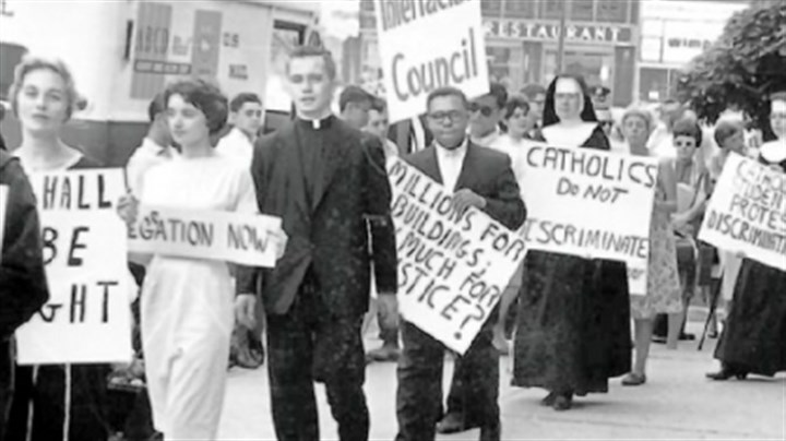 "'Band of Sisters' In a scene from ""Band of Sisters,"" one sign says ""Catholics do not discriminate."""