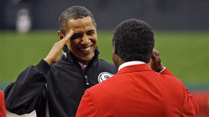 Barack Obama and Lou Brock President Barack Obama salutes former cardinals outfielder Lou Brock before the first inning.