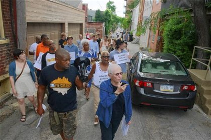 Barbara Luderowski speaks into megaphone Mattress Factory co-director Barbara Luderowski, right, speaks into a megaphone held by One Pittsburgh organizer Calvin Skinner as North Side community members march in opposition of proposed new Mexican War Street boundaries on Monday.