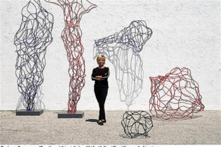 "Barbara Sorensen Barbara Sorensen with her wiry aluminum ""Dwellings V"" installation of 2010. This sculpture is not in the Manchester exhibition but she will talk about it Thursday."