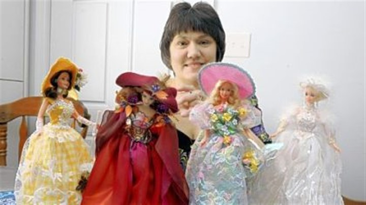 Barbie collection Kim Fancsali of Pleasant Hills with her four-season Barbie dolls. She has about 600 Barbie dolls.