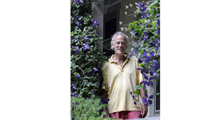 Basil Cox Basil Cox framed by clematis on his back porch.