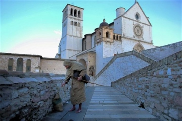 Basilica of St. Francis of Assisi Franciscan friar Massimo Coppo walks near the Basilica of St. Francis of Assisi, which sits above the saint's tomb in Assisi, Italy.