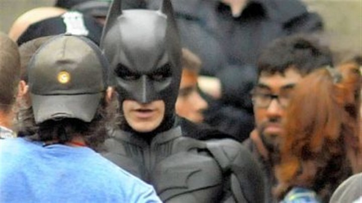 "Batman ""Batman"" speaks with production crew before filming a fight scene for ""The Dark Knight Rises"" in Oakland."