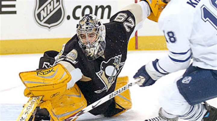 Begin slideshow Penguins Marc-Andre Fleury makes save on Leafs Chad Kilger in the first period.
