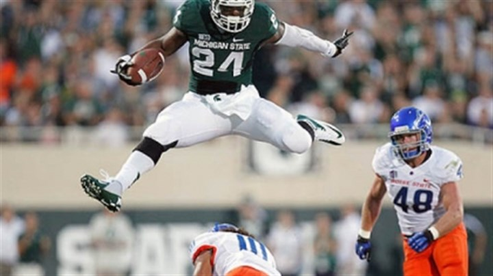 Bell leaps Le'Veon Bell, selected out of Michigan State by the Steelers in the second round of the NFL draft, leaps over a Boise State defender in a game last fall.