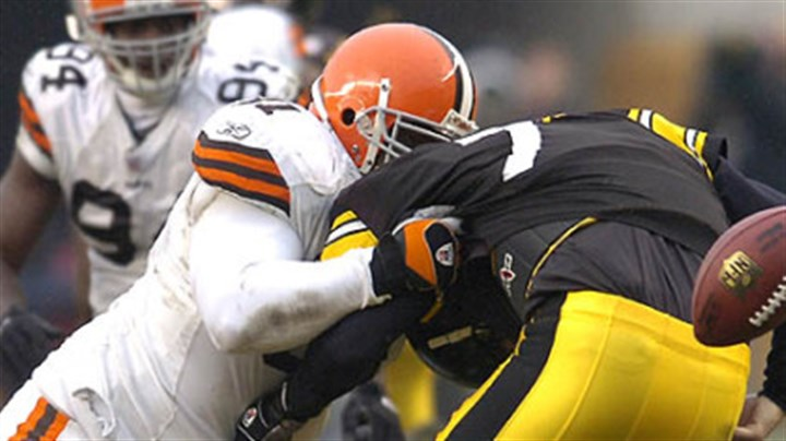 Ben Roethlisberger and Browns Shaun Smith Quarterback Ben Roethlisberger loses the football as he's taken down by Browns' defensive end Shaun Smith in the third quarter. (vs. Browns 11/11/07)