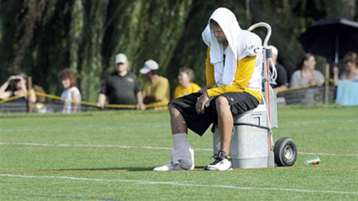Ben Roethlisberger injures ankle Quarterback Ben Roethlisberger sits on a water cooler near the end of practice, August 20, 2009. Roethlisberger injured his right foot when tackle Max Starks fell on him during pass drills near the end of practice.