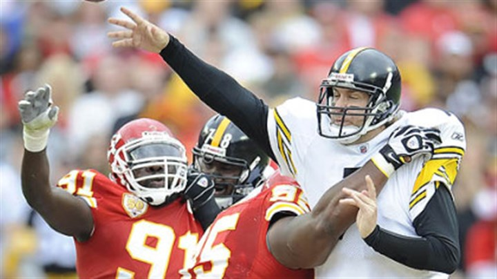 Ben Rothlisberger, Ron Edwards and Tamba Hali Pittsburgh Steelers quarterback Ben Roethlisberger is pressured by Chiefs defensive linemen Ron Edwards and Tamba Hali.