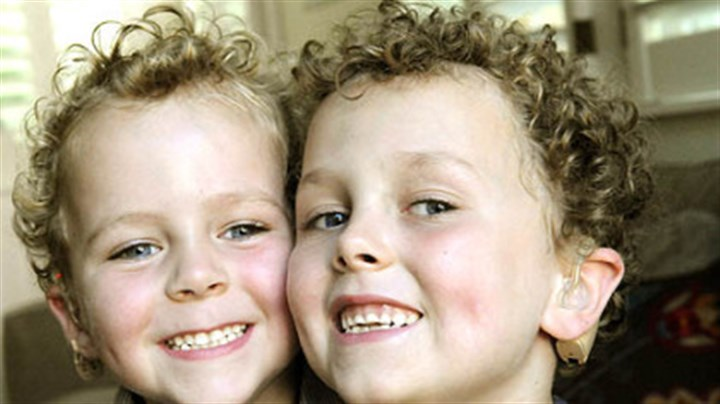 Bennett and Declan Haas Bennett Haas, 4, and his brother Declan, 6, both had cochlear implants and attend classes with hearing children.