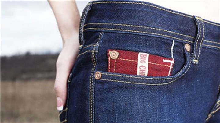 Big Chief Jeans Big Chief jeans logo on a red coin pocket, apparel designed by Brookline-based James Houk.