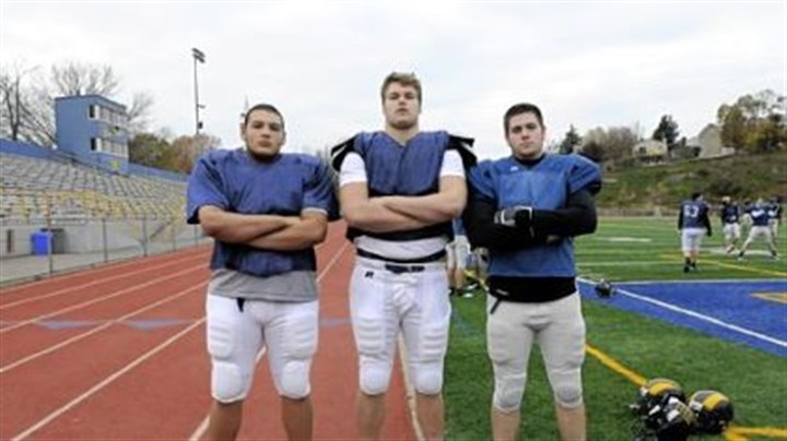 Big fellas Mt. Lebanon football players Ian Averberg-Johnson (6 feet, 290 pounds), Alex Bookser (6-6, 290) and Matt Hoffman (6-2, 230) represent the typical size of today's high school linemen at the Class AAAA level.