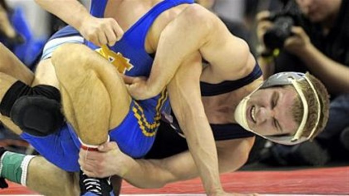 Big Macs Canon-McMillan's Nick Catalano, left, wrestles Central Mountain's Brian Brill in the 145-pound Class AAA match at the PIAA championships.
