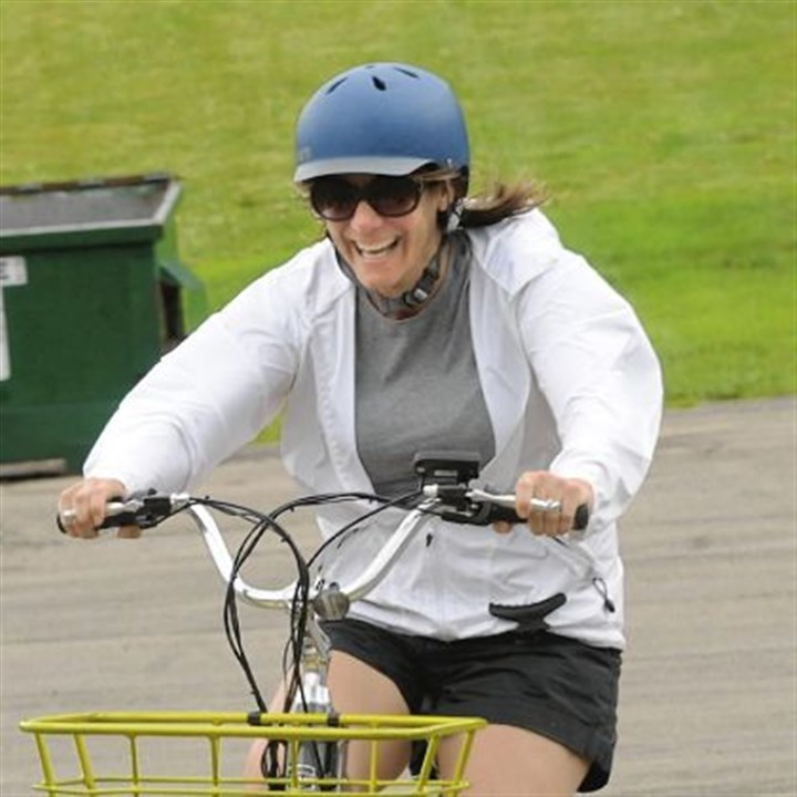 Bike 2 Lisa Malosh, a South Fayette commissioner, rides a pedal-assist electric bike.