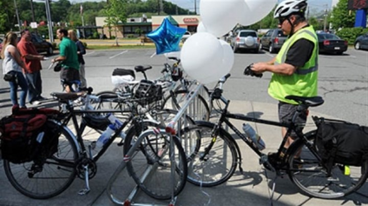 Biking to work Bill Edmonds of Robinson puts on his gear as he prepares to leave the event announcing the plan to extend a bike trail from McKees Rocks through Coraopolis. Mr. Edmonds stopped at the McKees Rocks event on his way to his Downtown job.