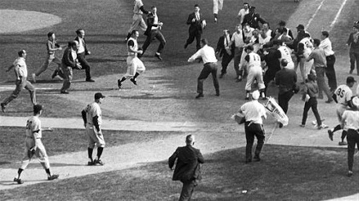 Bill Mazeroski and fans at home plate A crowd of fans and teammates greets Bill Mazeroski at home plate after his home run ending the 1960 World Series.