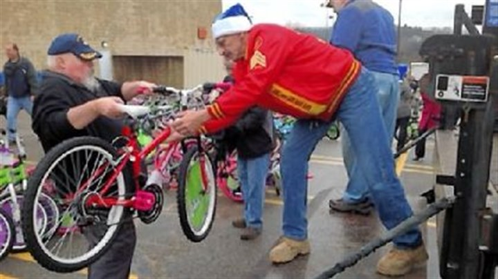 Bill Ringler and Andy Burch Bill Ringler, left, and Andy Burch, both of Tarentum, load some of the 300 bicycles donated by Al's Bike Drive to the Marine Corps Toys for Tots program on Tuesday. The men are members of the Allegheny Valley Detachment 827 of the Marine Corps League.