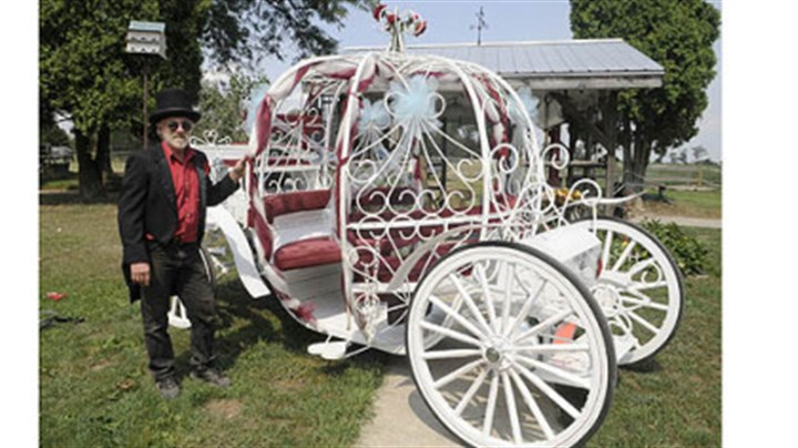 Bill Wolfe of Apollo Bill Wolfe of Apollo stands in front of a carriage used mostly for weddings at his horse-drawn carriage business, which supplies carriages for a variety of occasions.