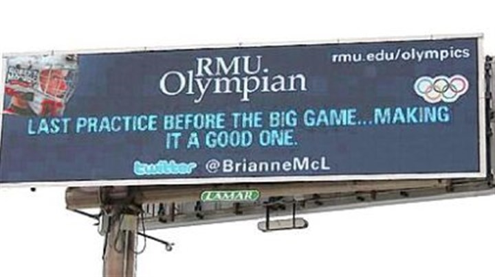 Billboard tweet A billboard along the Parkway West shows the first tweet by Brianne McLaughlin, a Robert Morris University student and a goalie for the U.S. women's hockey team at the Winter Olymics in Vancouver. Lamar Advertising sold the billboard space to the university.