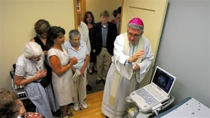 Bishop David Zubik blesses ultrasound Bishop David Zubik blesses the ultrasound machine Thursday at the North Side office of Women's Choice Network.