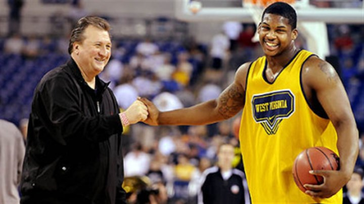 Bob Huggins and Danny Jennings West Virginia head coach Bob Huggins talks with Danny Jennings at Lucas Oil Stadium in Indianapolis at practice yesterday in preparation for their Final Four game against Duke.