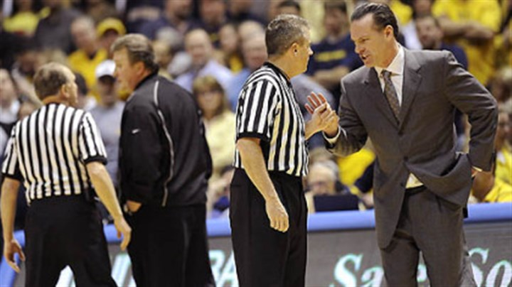 Bob Huggins and Jamie Dixon West Virginia head coach Bob Huggins, left, and Pitt coach Jamie Dixon talk with officials after a tussle between players occurred in the second half of Wednesday's game in Morgantown W.Va. Fans threw debris on the court twice during the contest.