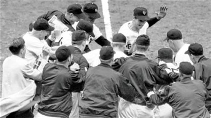 Bobby Thomson This Oct. 3, 1951, file photo shows the New York Giants baseball team greeting teammate Bobby Thomson, center rear with hand raised, after Thomson's ninth-inning homerun against the Brooklyn Dodgers, to give his team a 5-4 victory and a trip to the World Series, at the Polo Grounds in New York.