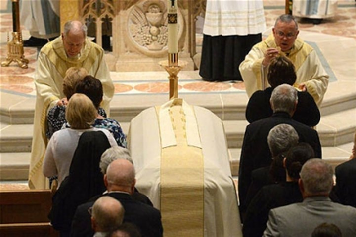 bosco funeral Mourners file past the casket of retired Greensburg Bishop Anthony Bosco to receive communion from Philadelphia Archbishop Charles Chaput, right, and Greensburg Bishop Lawrence Brandt at Bosco's funeral mass today.