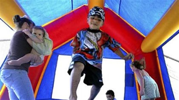 bounce house Every day, 31 children are seen in hospital emergency rooms nationwide with injuries suffered while playing in bounce houses such as this, according to a new study.