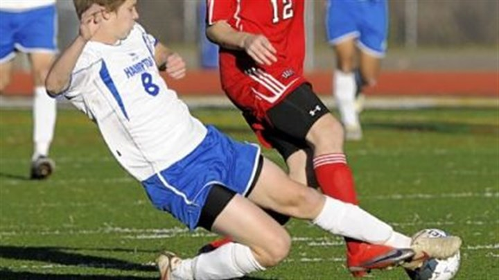 BOYS SOCER Hampton senior forward Jonathan Mercier, tackling a West Allegheny player in the second half of a PIAA Class AA soccer match last year, is one of only three returning starters for the Talbots.