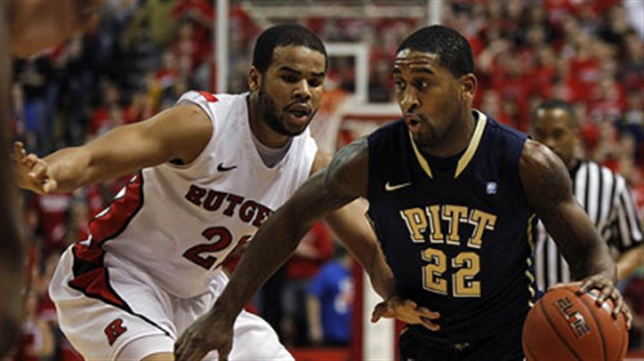 Brad Wanamaker and Austin Johnson Pitt's Brad Wanamaker dribbles Rutgers' Austin Johnson (21) defends during the first half of Saturday's game in Piscataway, N.J.