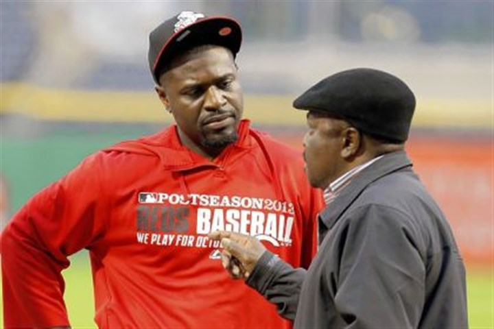 Brandon Phillips Current Reds second baseman Brandon Phillips, left, listens to former Reds second baseman Joe Morgan after taking batting practice Monday at PNC Park in anticipation of tonight's wild-card game.