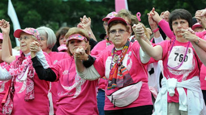 Breast cancer survivors unite Breast cancer survivors clasp hands during the Tribute to Survivors after they paraded across Flagstaff Hill at the 20th annual Susan G. Komen Race for the Cure in Schenley Park.