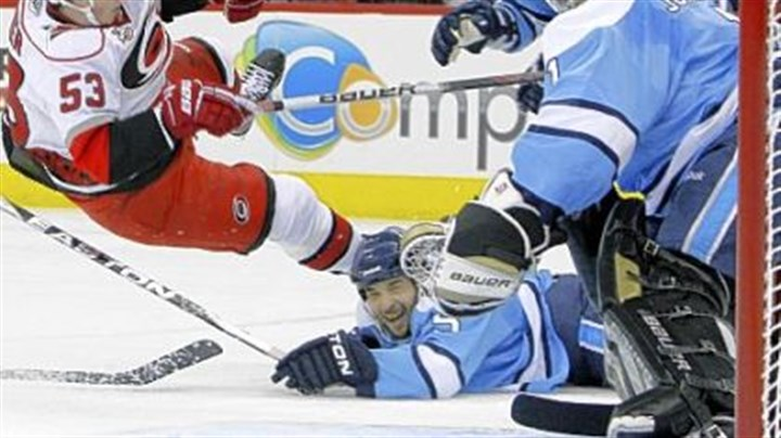 Brent Johnson Brent Johnson, right, denies Carolina's Jeff Skinner with a little help from Deryk Engelland Saturday night in Raleigh, N.C.