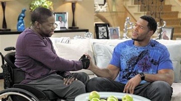 """Brothers"" Daryl ""Chill"" Mitchell, left, and Michael Strahan work things out in the new Fox comedy ""Brothers."""