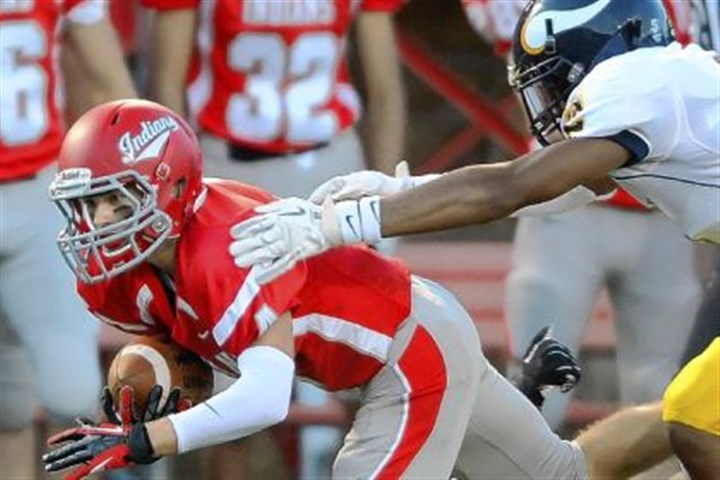 Brought down North Hills' Brandon Wagner is brought down by Central Catholic's Tre Tarpley on Friday at North Hills.