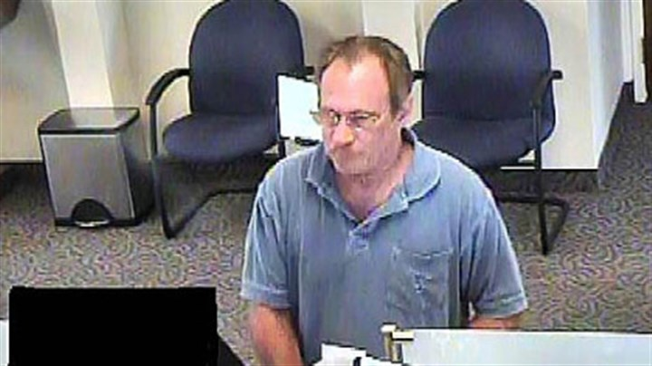 "Bucket List Bandit A photo captured from video Sept. 10 in an Erie bank of the robbery suspect known as the ""Bucket List Bandit,"" identified by the FBI as Michael Eugene Brewster."