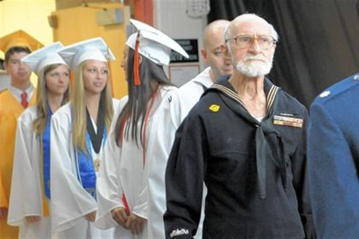 Bud Simon graduates Bud Simon, 88, processes with graduating seniors into Bethel Park High School's auditorium for the school's 104th commencement ceremony. He missed his 1944 commencement ceremony because he joined the U.S. Navy to fight in World War II. On Saturday he finally received his high school diploma.