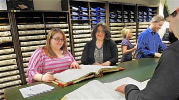 Butler records search Butler County Recorder of Deeds Michelle Mustello, second from left, helps Meagan Ambrosini, 20, look for grantor records.