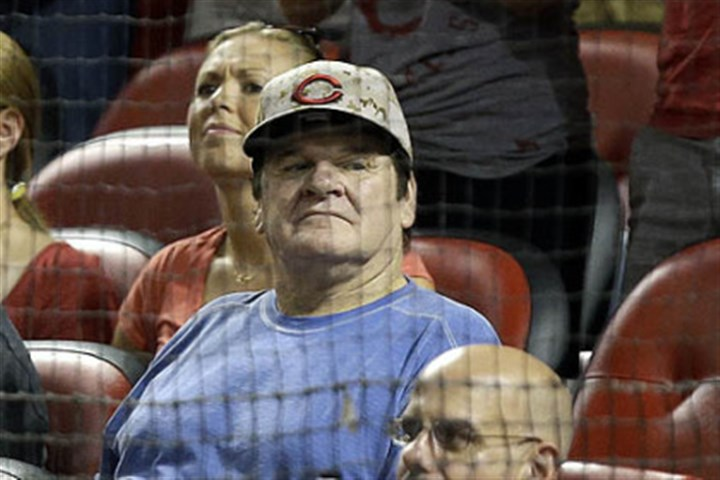 By any other name Former Cincinnati Reds great Pete Rose watches from the stands in the eighth inning of the Reds-Pirates game.