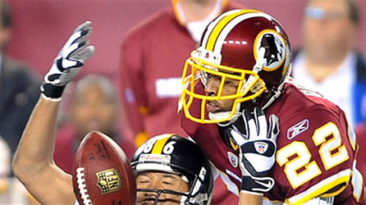 Can't pull in a pass Hines Ward can't pull in a pass in front of the Redskins' Carlos Rogers.