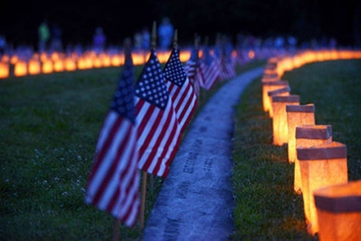 candles lit at gettysburg Luminaria are lit Sunday evening at Soldiers' National Cemetery marking each of the more than 3,500 graves of soldiers killed in the Battle of Gettysburg.