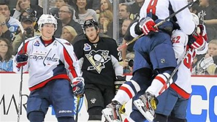 Capitals 3, Penguins 2, OT The Capitals celebrate a power-play goal by Dennis Wideman at 2:48 in overtime Thursday at Consol Energy Center