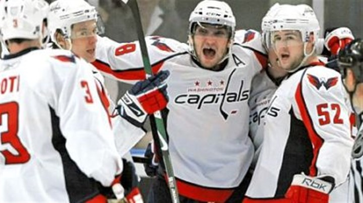 Capitals' Alex Ovechkin The Capitals' Alex Ovechkin, center, celebrates with teammates after scoring in the second period against the Rangers yesterday at Madison Square Garden in New York. The Capitals went on to win and force a Game 7 in Washington in the first-round NHL playoffs series.
