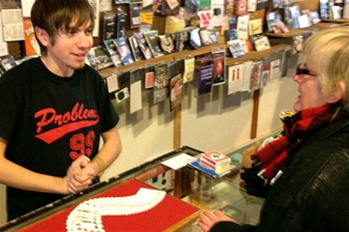Cards Vince Smith, 18, demonstrates illusions using a deck of cards at the Cuckoo's Nest on the South Side.